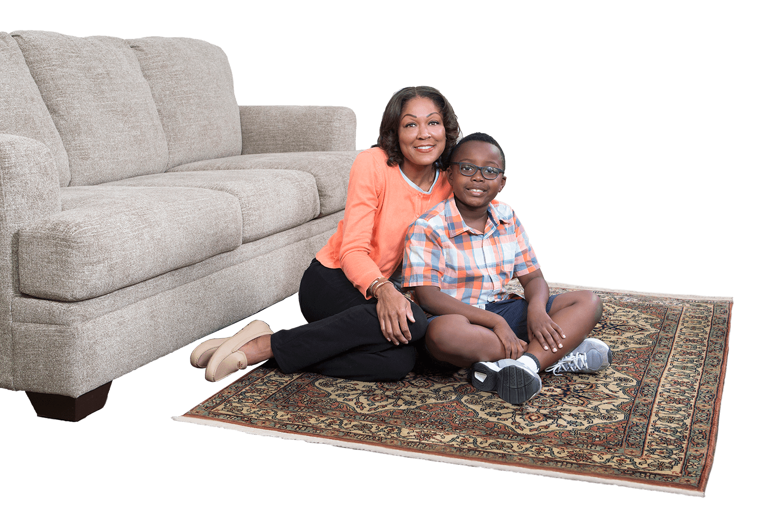 mother and child sitting on clean area rug